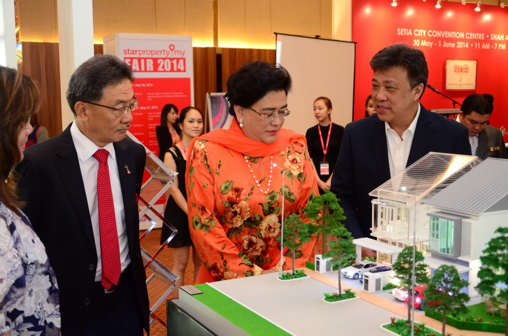 (From left) Real Estate & Housing Development Association president Datuk Seri Michael Yam, Ministry of Urban Wellbeing, Housing and Local Government deputy minister Datuk halimah Mohamed Sadique and Star Publications Berhad group chief executive officer Datuk Seri Wong Chun Wai visiting one of the 30 exhibition booths in the StarProperty Fair 2014 launch at Setia City Convention Centre