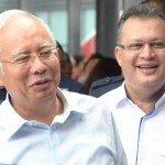(From left) Prime Minister Datuk Seri Najib and MRCB group managing director Tan Sri Mohamad Salim during the brisk tour of  the KL Sentral Station and Nu Sentral Mall.