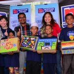 From back to left: Nippon Paint group general manager Goh, Rumah Kasih Harmoni principal Jamal and PKGG's Choong with the children of Rumah Kasih Harmoni.