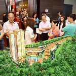 On display: Visitors looking at one of the projects at the property fair at G Hotel in Gurney Drive, Penang.