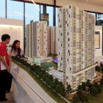 Service apartments: Visitors looking at the model towers of 8scape Residences Sutera developed at its show gallery in Taman Sutera, Johor Baru.
