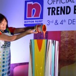 Nippon Paint group general manager Gladys Goh pouring the final colour on the Nippon Paint Trend Toast display.