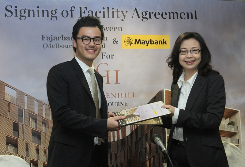Loan deal: Chan and Maybank corporate banking MD Caroline Teoh at the agreement signing for a bridging loan facility for the Gardenhill condo project in Melbourne.
