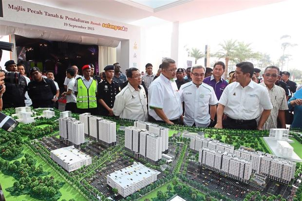 New township in the works: Azmin (front row, right), Liew (front row, second from right) and Iskandar (front row, third from right) viewing Eco World's scale model at the Eco World Gallery @ Eco Majestic in Semenyih on Saturday.